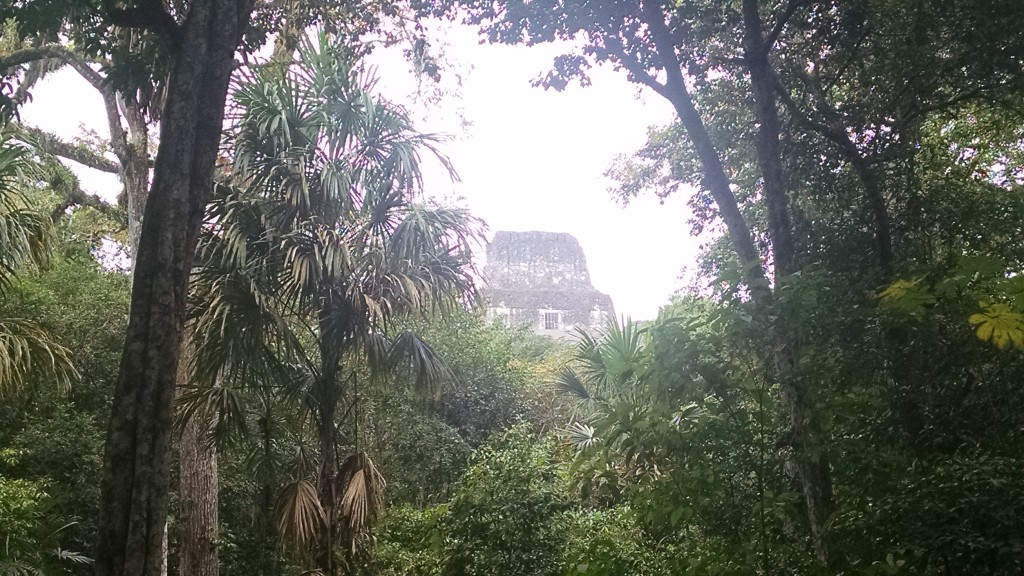 Top of a Mayan temple through the clouds